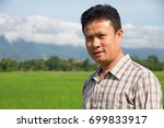 asian man farmer standing smile ... | Shutterstock . vector #699833917