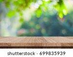 empty wooden table over blurred ... | Shutterstock . vector #699835939