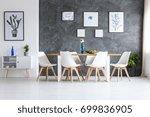 flowers in blue glass vase on... | Shutterstock . vector #699836905
