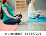 meditating pregnant women in... | Shutterstock . vector #699847201