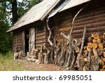 Wooden House In The Forest Wit...