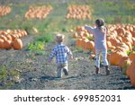 happy kids running to choose... | Shutterstock . vector #699852031