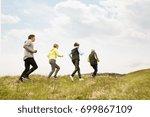 group of seniors running... | Shutterstock . vector #699867109