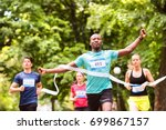 young man running in the crowd... | Shutterstock . vector #699867157