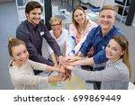 six happy  smiling work... | Shutterstock . vector #699869449