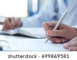 female doctor filling medical... | Shutterstock . vector #699869581