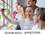a team of happy  smiling work... | Shutterstock . vector #699875599