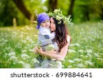 mother walks with kids in the... | Shutterstock . vector #699884641