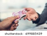 businessman giving money ... | Shutterstock . vector #699885439