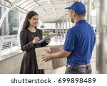 woman hand accepting a delivery ... | Shutterstock . vector #699898489