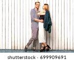 fashion couple standing near a... | Shutterstock . vector #699909691