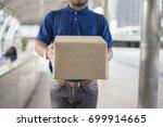 delivery man in blue uniform... | Shutterstock . vector #699914665