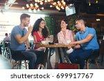 photo of friends having coffee... | Shutterstock . vector #699917767
