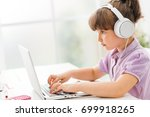 smart cute girl connecting with ... | Shutterstock . vector #699918265