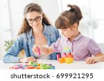 young mother and daughter... | Shutterstock . vector #699921295