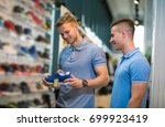 two man deciding on new sports... | Shutterstock . vector #699923419