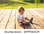 smiling happy baby boy on... | Shutterstock . vector #699936529