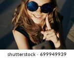 beautiful woman in glasses... | Shutterstock . vector #699949939
