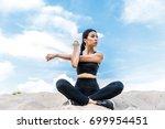 asian sportswoman stretching... | Shutterstock . vector #699954451