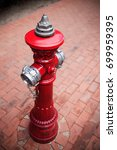 old style fire hydrant in red...