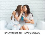two cute girls at home | Shutterstock . vector #699960607