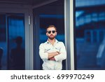 handsome man with arms crossed... | Shutterstock . vector #699970249