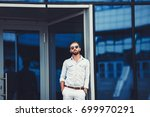 stylish handsome man in shirt... | Shutterstock . vector #699970291