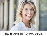smiling blond businesswoman... | Shutterstock . vector #699970525