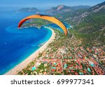 paragliding in the sky.... | Shutterstock . vector #699977341