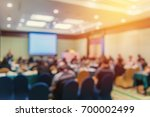blur of business conference and ... | Shutterstock . vector #700002499