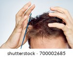 hair with a close up comb on a... | Shutterstock . vector #700002685