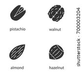 nuts types glyph icons set.... | Shutterstock .eps vector #700003204