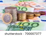banknotes and euro coins   Shutterstock . vector #700007377