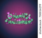 happy halloween neon sign with... | Shutterstock .eps vector #700016299