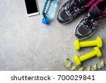 sport accessories on gray stone ...   Shutterstock . vector #700029841