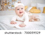 baby girl wearing cute dress... | Shutterstock . vector #700059529