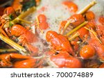 craw fish in boiled water | Shutterstock . vector #700074889