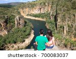 couple on a rock overlooking a... | Shutterstock . vector #700083037