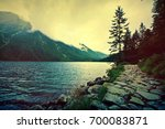 lake in mountains. fantasy and... | Shutterstock . vector #700083871