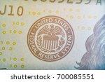 Small photo of Macro close up of US $100 dollar bill.