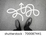 businessman in black leather... | Shutterstock . vector #700087441