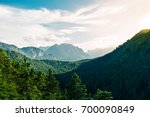 sunset in the alps in austria | Shutterstock . vector #700090849