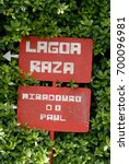 Red Signpost Lettered In White...