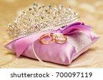 golden wedding rings on the...   Shutterstock . vector #700097119