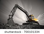 excavator parked on stone... | Shutterstock . vector #700101334