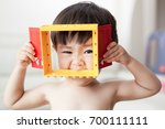 cute and naked baby boy smile... | Shutterstock . vector #700111111