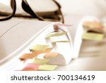 Small photo of Close up White book marked by sticky note