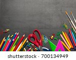 colored school supplies on a... | Shutterstock . vector #700134949
