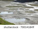 rain puddles on a pad | Shutterstock . vector #700141849