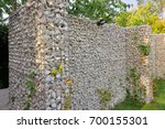 gabion fence made of natural... | Shutterstock . vector #700155301